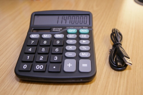 Desktop Calculator with Hidden Voice Recorder